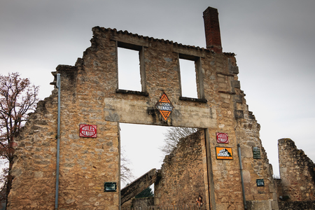 ORADOUR SUR GLANE, FRANCE - December 03, 2017 : remains in ruins destroyed by the fire of the RENAULT garage after the massacre of the population on June 10, 1944