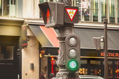 PARIS, FRANCE - May 08, 2017 : typical red traffic light in a Paris street on a gray spring day Editoriali