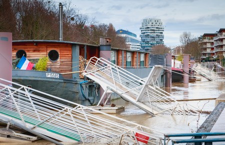 ISSY LES MOULINEAUX near PARIS, FRANCE - January 24, 2018 : Difficult access to barges along the river Seine because of the rising waters during winter floods