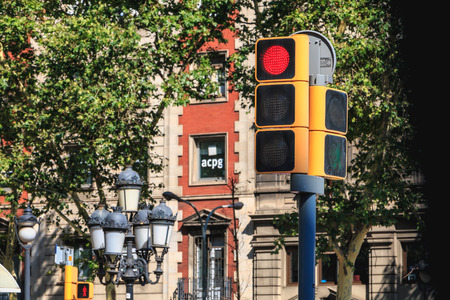 BARCELONA, SPAIN - June 20, 2017 : traffic light in a city street which prohibits the passage of vehicles at a crossroads on a summer day