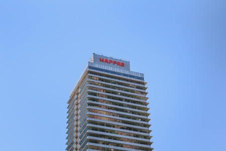 BARCELONA, SPAIN - June 21, 2017 : architectural detail of the MAPFRE tower during the summer, a skyscraper designed by the architects Inigo and Enrique de Leon and built for the 1992 Summer Olympics