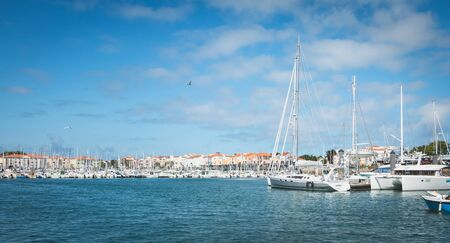 Sables d Olonne, France - July 24, 2016 : peaceful atmosphere in the harbor among the pleasure boats on a summer day