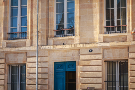 Bordeaux, France - January 26, 2018 : architectural detail of the facade of the annex of the city hall on a winter day Editoriali