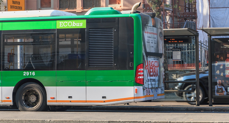 Milan, Italy - November 03, 2017: A bus stopped at a station during his driver's break on a fall day Editorial