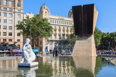 Barcelona, Spain - June 20, 2017 : in the middle of Catalonia square, a sculpture of a naked woman bathing, named the goddess (La Deessa), by Spanish sculptor Josep Clara Editorial