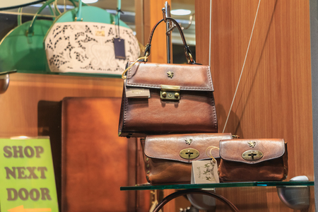 Bellagio, Italy - November 04, 2017 : example of a well-known night and autumn store showcase that sells Italian women bags and accessories