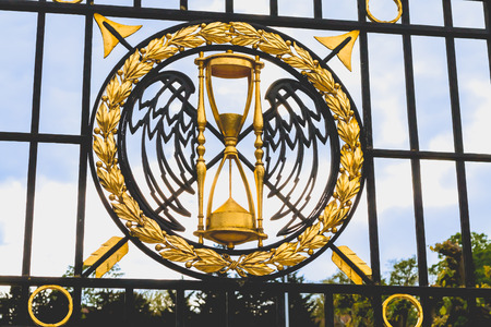 Suresnes, France - May 02, 2017 : detail of the gilding of a wrought iron gate on a spring day at the entrance of the American cemetery of the second world war