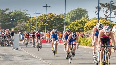 Saint Gilles Croix de Vie, France - September 10, 2016 : Final triathlon championship of France in the category D3 - cyclists straight for a road bike race Editorial
