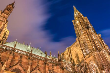 architectural detail of Notre-Dame cathedral of Strasbourg by night on a winter day. Gothic style, its construction began in 1176 Editorial