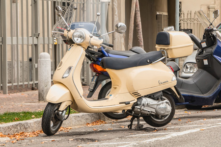 Como, Italy - November 4, 2017: A typical Italian Vespa scooter parked in a street in the city center on a fall day