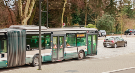 Strasbourg, France - December 28, 2017 : bus of the Strasbourg public transport company (CTS) which is stopped at a bus stop on a winter day