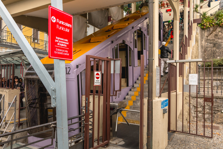 Como, Italy - 4 November 2017: detail of a Como funicular station on a fall day. Commissioned in 1894, it connects the center of Como and Brunate, village on a mountain at 715 meters above sea level.