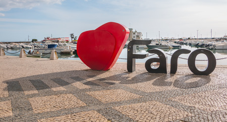 Faro, Portugal - May 1, 2018: Faro city logo name with big letters near the marina on a spring day