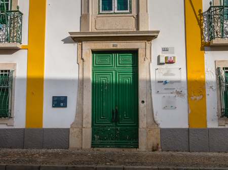 Faro, Portugal - May 1, 2018: Architectural detail of the Ministry of the Environment (Ministério do Ambiente) in the historic city center of Faro on a spring day