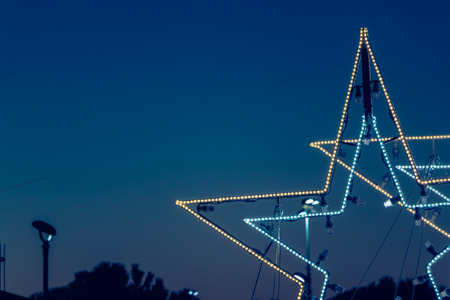 christmas star in led light on night background Stock Photo
