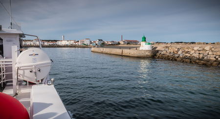 Ile d Yeu, France - September 16, 2018: View of the bridge of a ferry that enters the harbor of the island of Yeu where travelers are sitting to admire the show on a summer day
