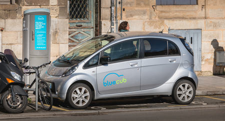 Bordeaux, France - January 26, 2018: Bluecub shared electric car parked in the city center on a reserved place on a winter day