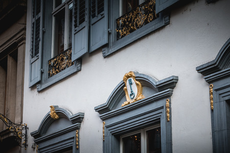 Basel, Switzerland - December 25, 2017 - architectural detail of the former house of the corporation of the locksmith of Basel on a winter day Standard-Bild - 111380817