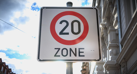 white square road sign that indicates entry into an area with limited speed of 20 km  h Banco de Imagens