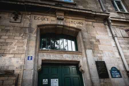 Paris, France - October 6, 2018: Facade of the Foyatier Elementary School in the middle of the Montmartre neighborhood on a fall day where it is written School of Boys - Liberty - Equality - Fraternity