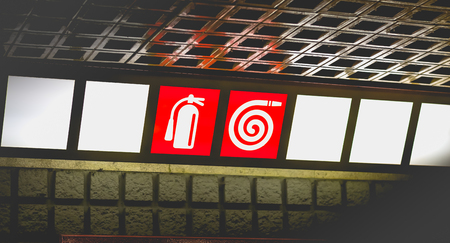 red sign on bright background indicating access to extinguishers and fire ramps Banque d'images