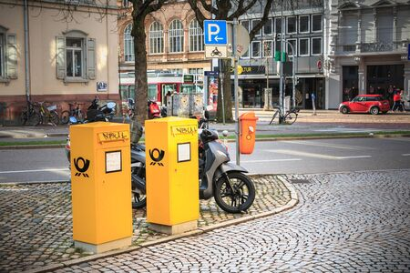 Freiburg im Breisgau, Germany - December 31, 2017: Yellow post office boxes in the city center on a winter day