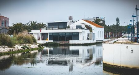 Aveiro, Portugal - May 7, 2018: beautiful architecture detail modern house in the city center near a water channel on a spring day Foto de archivo - 128464599