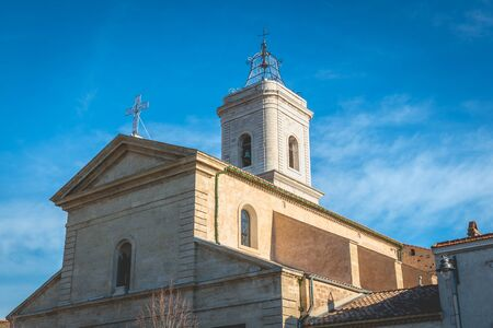 Marseillan, France - December 30, 2018: Architectural detail of Saint John the Baptist Church in the historic city center on a winter day Foto de archivo - 128464618