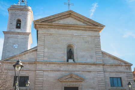 Marseillan, France - December 30, 2018: Architectural detail of Saint John the Baptist Church in the historic city center on a winter day Foto de archivo - 128464620