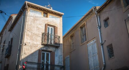 Marseillan, France - December 30, 2018: architectural detail of small typical townhouses in the historic town center of a small fishing port in the south of France on a winter day Foto de archivo - 128464623