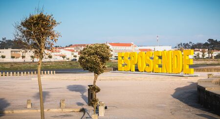 Esposende, Portugal - May 8, 2018: Big yellow block letters spelling Esposende on the beach on a spring day Foto de archivo - 128464666