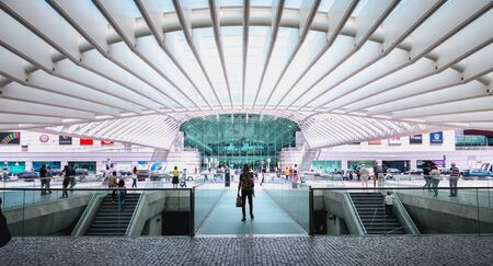Lisbon, Portugal - May 7, 2018: people walking in front of Oriente Intermodal Station Lisbon, a railway and road station completed in 1998 for Expo 98 Foto de archivo - 128464671