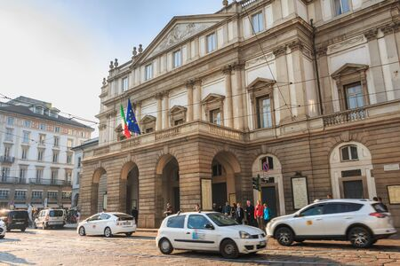 Milan, Italy - November 3, 2017: Cars driving in front of the famous Scala Theater in the historic city center on a fall day