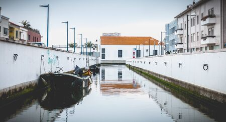 Aveiro, Portugal - May 7, 2018: Small boat docked on a canal in the city on a spring day Foto de archivo - 128464680