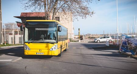 Sete, France - January 4, 2019: Bus parked near the bus station waiting for passenger on a winter day Foto de archivo - 128464690