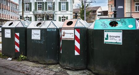 Freiburg im Breisgau, Germany - December 31, 2017: garbage container for selective sorting of garbage on the street on a winter day Banque d'images - 128352225