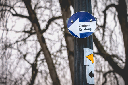 center roundabout in german on a small blue sign in a park