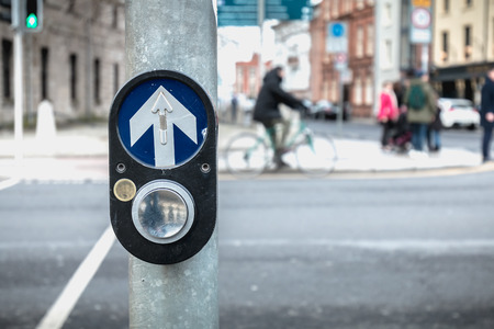 button to activate pedestrian crossing on the road on a pedestrian crossing in the city center on a winter day