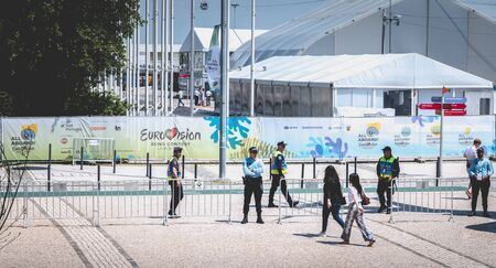 Lisbon, Portugal - May 7, 2018: Security team monitoring the entrances to 2018 Eurovision on a spring day Editorial