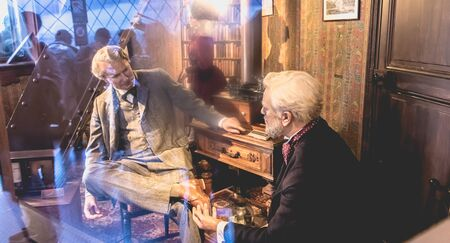 Paris, France - October 8, 2017: Gustave Eiffel and Thomas Edison wax figure in office is located to the top of the Eiffel Tower. Paris, France Editorial