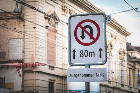 road sign no turning back taxi way in German on a street in Switzerland