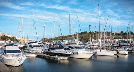 Albufeira, Portugal - May 3, 2018: view of the luxurious marina of Albufeira where are parked tourist boats on a spring day 版權商用圖片 - 128352636