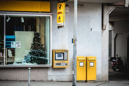 Freiburg im Breisgau, Germany - December 31, 2017: View of a post office in a shopping street downtown on a winter day