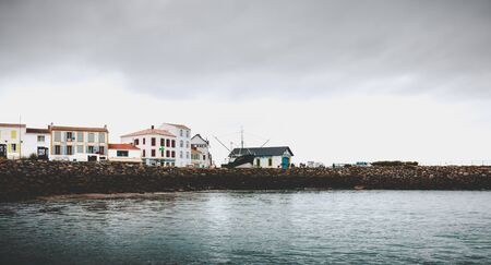 Port Joinville on the island of Yeu - September 18, 2018: entrance to the port of the island of Yeu with its semaphore and typical small houses on a fall day