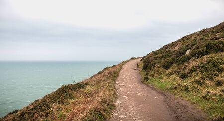 hiking trail on cliff skirting the sea in Howth, Ireland Zdjęcie Seryjne