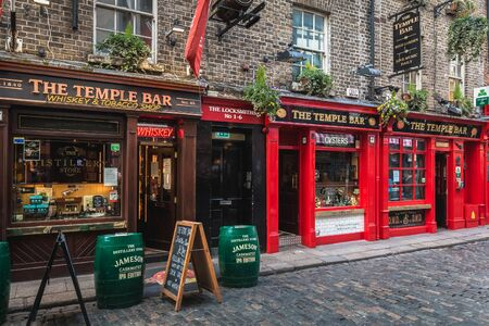 Dublin, Ireland - February 16, 2019: Temple Bar District - street atmosphere in the famous Irish pub district Temple Bar where people are walking on a winter day