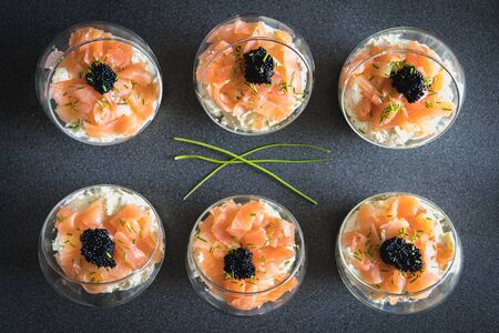 verrine salmon lumpfish egg fresh cheese and avocado bed in the kitchen