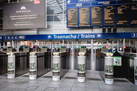 Dublin, Ireland - February 15, 2019: View of the entrance gantries on the platform of the Connolly DART train station (Staisiun ui Chonghaile) on a winter day Publikacyjne