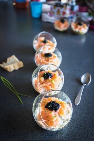verrine salmon lumpfish egg fresh cheese and avocado bed in the kitchen Banque d'images
