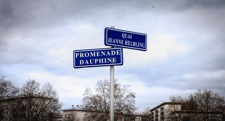 blue street sign where it is written in French Quai (dock) Jeanne Helbling and promenade Dauphine in Strasbourg